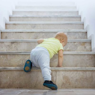 Baby Climbining Stair Illustrating a Lack of Direction